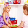 Children in kindergarten stacking block. — Stock Photo