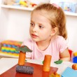 Child playing plasticine in kindergarten — Stock Photo