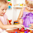 Children playing plasticine in kindergarten — Stock Photo
