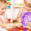 Children playing plasticine in kindergarten — Stock Photo #11831864