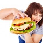 Woman eating hamburger. — Stock Photo #11831967