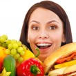 Woman choosing between fruit and hamburger. — Foto Stock