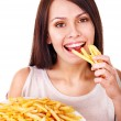 Stock Photo: Woman eating french fries.