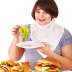 Woman choosing between fruit and hamburger. — Stock Photo #11832201