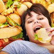 Woman eating hot dog. — Stock Photo