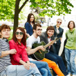 Group of in city park listen music. — Stock Photo #11832345