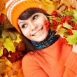 Young woman in autumn orange leaves. — Stock Photo