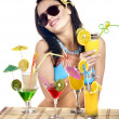 Girl on beach drinking cocktail. — Stock Photo #11832801