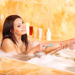 Woman shaving her legs in bath. — Stock Photo #11833018