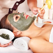 Clay facial mask in beauty spa. — Stock Photo #11833583