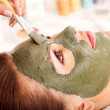Clay facial mask in beauty spa. — Stock Photo #11833605