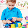 Child playing construction set. — Stock Photo #11833717