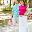 Pregnant woman with man outdoor. — Стоковое фото