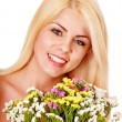 Woman holding flowers. — Stock Photo