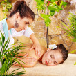 Beautiful young woman getting massage in spa. - Stock Photo