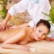 Woman getting massage in spa. - Foto Stock
