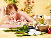 Woman getting herbal ball massage treatments . — Stock Photo