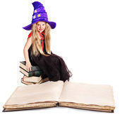 Witch little girl with stack book. Halloween. — Stock Photo
