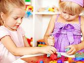 Children playing plasticine in kindergarten — Stock Photo