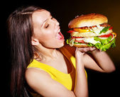 Woman bite hamburger. — Stock Photo
