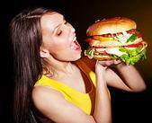 Woman bite hamburger. — Stock Photo
