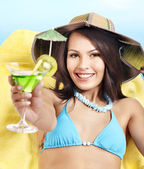 Girl in bikini drink juice . — Stockfoto
