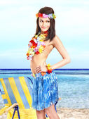 Woman in hawaii costume drink juice. — Stock Photo