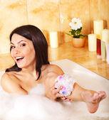 Woman relaxing in bubble bath . — Stock Photo