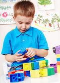 Child playing construction set. — Stock Photo