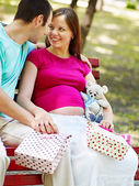 Pregnant woman with man outdoor. — Stock Photo