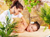 Beautiful young woman getting massage in spa. — Stock Photo