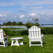 Stock Photo: Single senior min white chairs overlooking bay