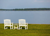 Pair of garden chairs by Chesapeake bay — Stock Photo