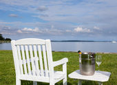 Garden chair and champagne by Chesapeake bay — Stock Photo