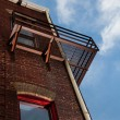Royalty-Free Stock Photo: Fire escape on brick building from below