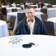 Stock Photo: Man crying in empty conference room