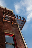Fire escape on brick building from below — Stock Photo