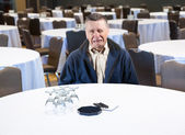 Man crying in empty conference room — Stock Photo