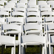 Rows of wooden chairs set up for wedding — Stock Photo #11233407