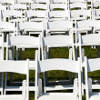 Rows of wooden chairs set up for wedding — Stock Photo #11233416