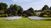 Rows of wooden chairs set up for wedding — ストック写真