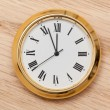 Brass small watch or clock on wood table — Stock Photo