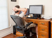 Senior male working in home office — Stok fotoğraf