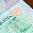 Visa for Cambodia in US passport - Stock Photo