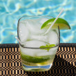 Cocktail Majito on edge by poolside — Stock Photo