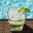 Stock Photo: Cocktail Majito on edge by poolside