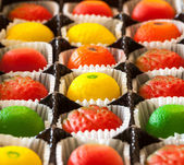 Macro image of marzipan fruit candies — Stock Photo