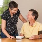 Senior man taking blood pressure with wife — Stock Photo