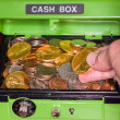 Green cash box with gold and silver coins — Stock Photo
