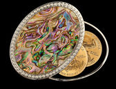Iridescent mother of pearl box gold coins — Stock Photo